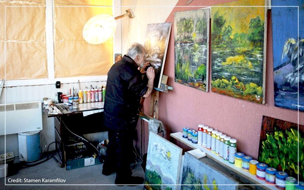 Artist Stamen Karamfilov works on a painting at his studio in the city of Plovdiv, Bulgaria.