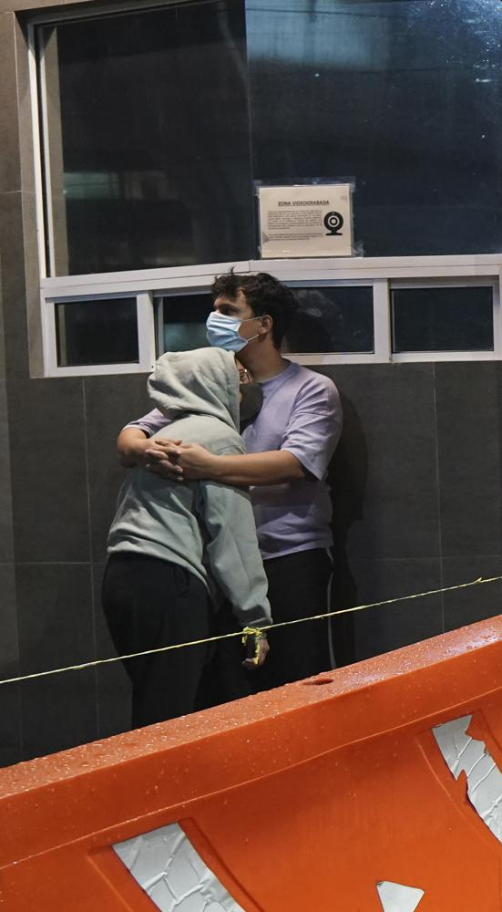 A couple embraces outside a building after a strong earthquake, in Mexico City. Credit: AP