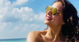 Bipasha Basu poses in yellow swimsuit while sunbathing in Maldives; see pics