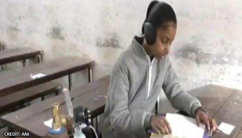 Girl bound to oxygen cylinder due to lung disease gives her board exam