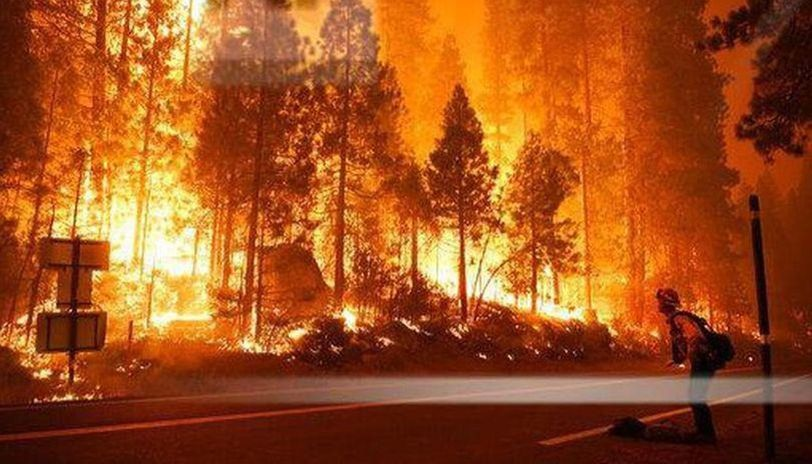 California: Thousands battle power cuts as storm exacerbates wildfires