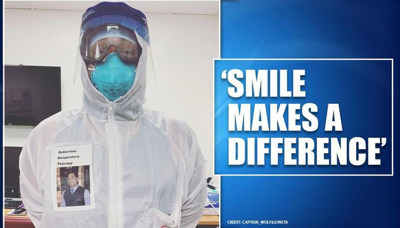 US doctor wears badge with his smiling face on it to comfort coronavirus patients