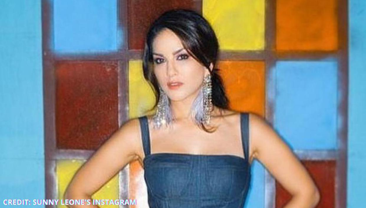 Sunny Leone rocks a casual look as she poses against a pretty backdrop