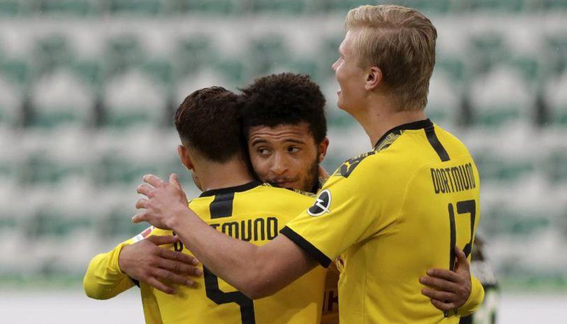 No fans, but Dortmund keeps Bundesliga title challenge alive