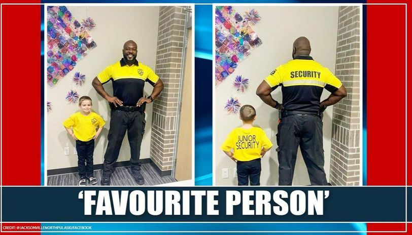 5 year old dressed as security officer for special day