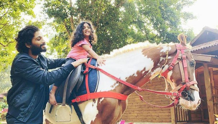 Allu Arjun and his daughter with horse