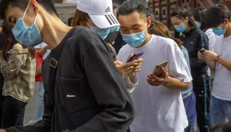 Wuhan raises its daily coronavirus testing as asymptomatic cases surge