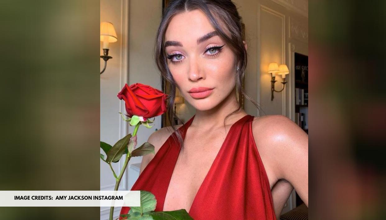 Amy Jackson sizzles in red as she poses with her dog