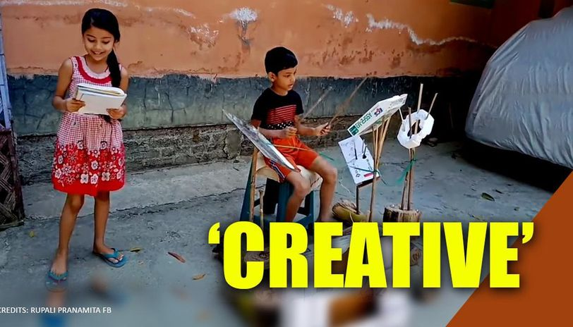 Siblings perform with drums made from cardboard and steel tray in Assam